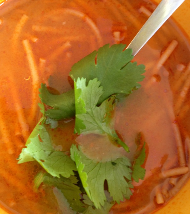 Sopa de Fideo with cilantro garnish.