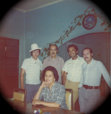 1970's - Sitting front and center: abuelita Elvira with my grandfather, dad and uncles behind her.